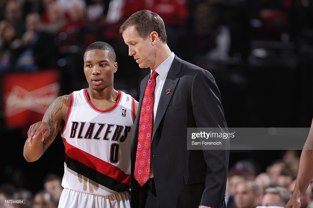 <a gi-track='captionPersonalityLinkClicked' href=/galleries/search?phrase=Damian+Lillard&family=editorial&specificpeople=6598327 ng-click='$event.stopPropagation()'>Damian Lillard</a> #0 of the Portland Trail Blazers discuesses a play during a time out against the Minnesota Timberwolves on November 23, 2012 at the Rose Garden Arena in Portland, Oregon.