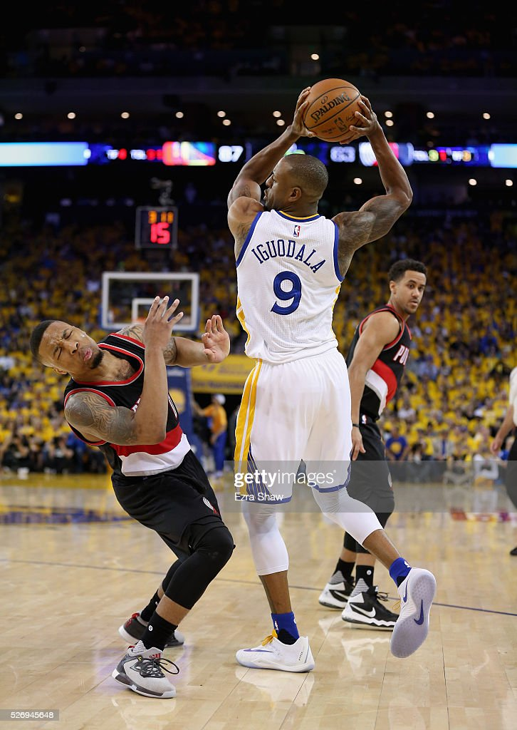 Damian Lillard #0 of the Portland Trail Blazers draws the offensive foul on Andre Iguodala #9 of the Golden State Warriors during Game One of the Western Conference Semifinals for the 2016 NBA Playoffs at ORACLE Arena on May 01, 2016 in Oakland, California.
