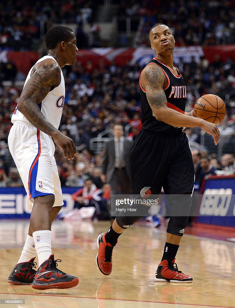 Damian Lillard #0 of the Portland Trail Blazers dribbles in front of Eric Bledsoe #12 of the Los Angeles Clippers at Staples Center on January 27, 2013 in Los Angeles, California.