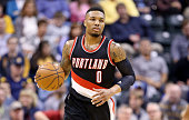 Damian Lillard of the Portland Trail Blazers dribbles the ball during the game against the Indiana Pacers at Bankers Life Fieldhouse on February 28...