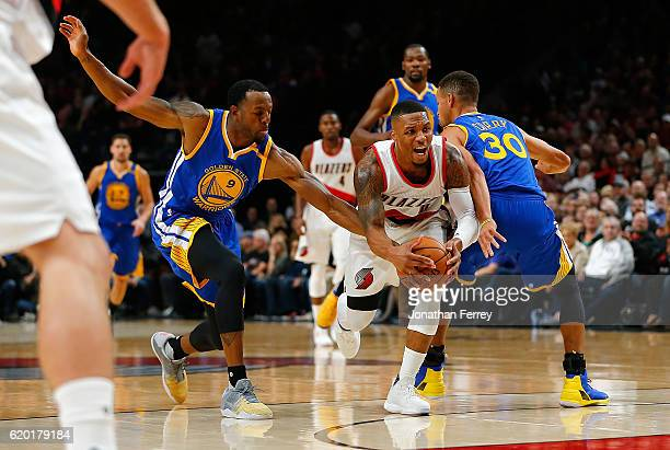 Damian Lillard of the Portland Trail Blazers dribbles the ball against Stephen Curry of the Golden State Warriors at Moda Center on November 1 2016...