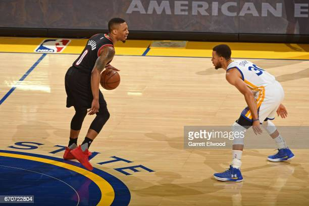 Damian Lillard of the Portland Trail Blazers dribbles the ball against Stephen Curry of the Golden State Warriors during the Western Conference...