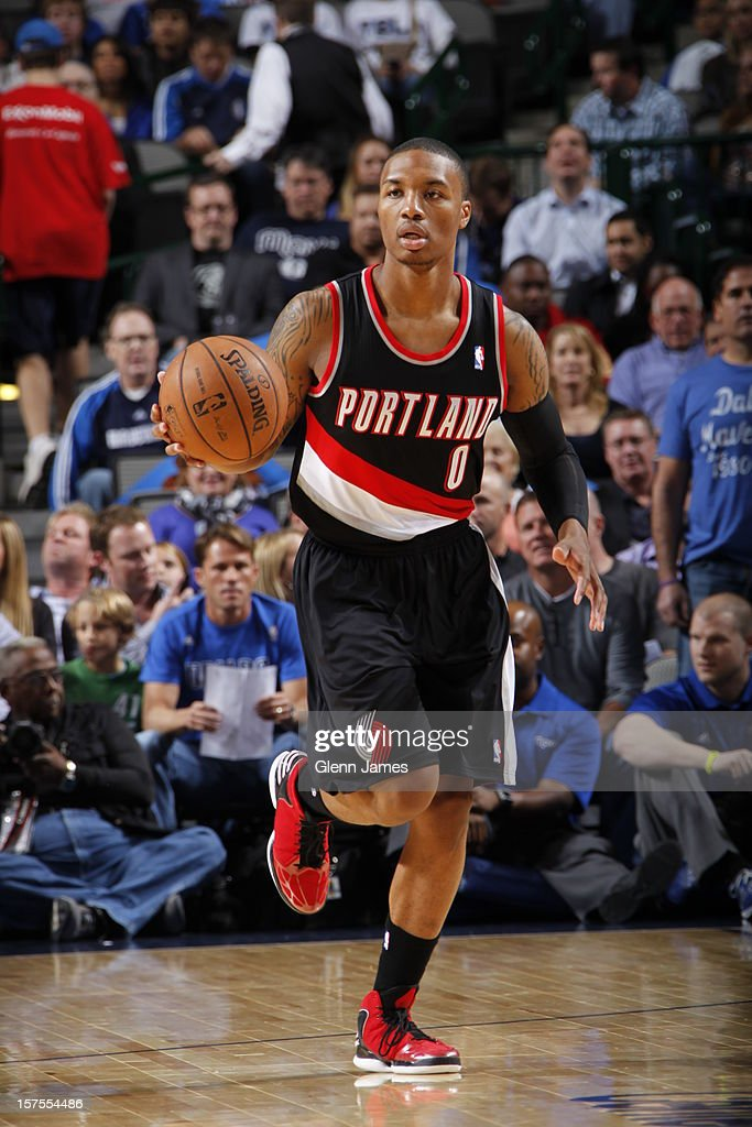 <a gi-track='captionPersonalityLinkClicked' href=/galleries/search?phrase=Damian+Lillard&family=editorial&specificpeople=6598327 ng-click='$event.stopPropagation()'>Damian Lillard</a> #0 of the Portland Trail Blazers dribbles the ball upcourt against the Dallas Mavericks on November 5, 2012 at the American Airlines Center in Dallas, Texas.