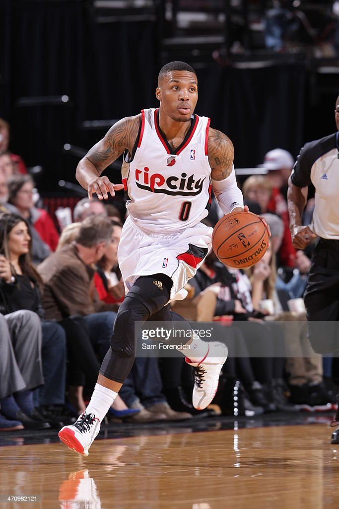 <a gi-track='captionPersonalityLinkClicked' href=/galleries/search?phrase=Damian+Lillard&family=editorial&specificpeople=6598327 ng-click='$event.stopPropagation()'>Damian Lillard</a> #0 of the Portland Trail Blazers dribbles the ball against the San Antonio Spurs on February 19, 2014 at the Moda Center Arena in Portland, Oregon.