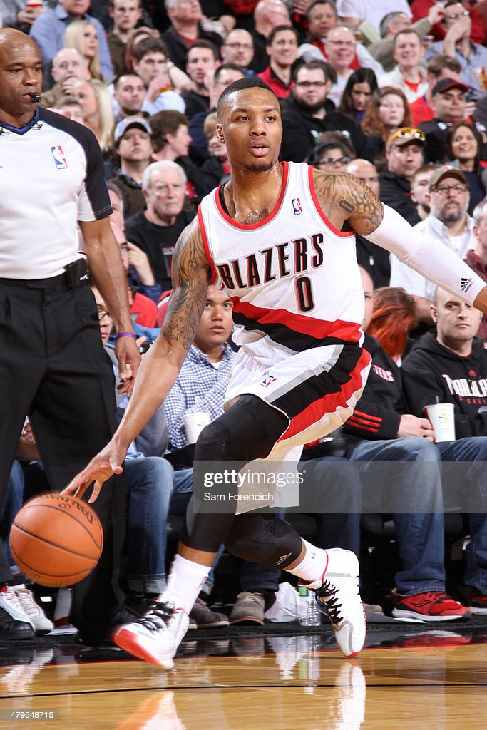 Damian Lillard #0 of the Portland Trail Blazers dribbles the ball against the Milwaukee Bucks on March 18, 2014 at the Moda Center Arena in Portland, Oregon.