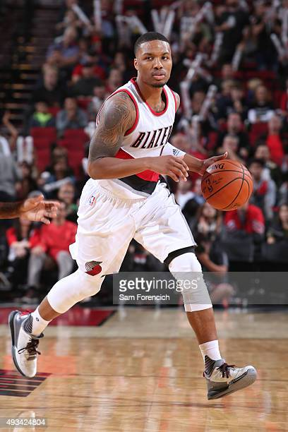 Damian Lillard of the Portland Trail Blazers dribbles the ball against the Utah Jazz during a preseason game on October 18 2015 at the Moda Center...