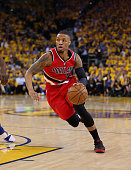 Damian Lillard of the Portland Trail Blazers dribbles the ball against the Golden State Warriors during Game Five of the Western Conference...