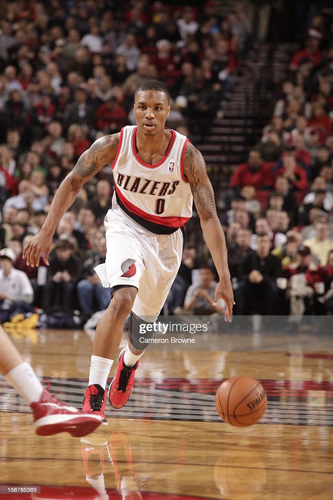<a gi-track='captionPersonalityLinkClicked' href=/galleries/search?phrase=Damian+Lillard&family=editorial&specificpeople=6598327 ng-click='$event.stopPropagation()'>Damian Lillard</a> #0 of the Portland Trail Blazers dribbles the ball up court against the Denver Nuggets on December 20, 2012 at the Rose Garden Arena in Portland, Oregon.
