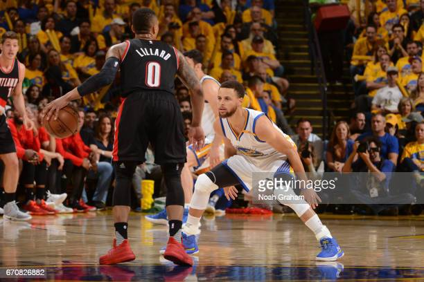 Damian Lillard of the Portland Trail Blazers dribbles the ball while guarded by Stephen Curry of the Golden State Warriors during Game Two of the...