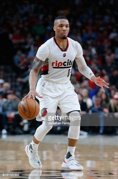 Damian Lillard of the Portland Trail Blazers dribbles the balll against the Golden State Warriors during Game Four of the Western Conference...