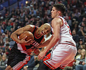 Damian Lillard of the Portland Trail Blazers drives against Doug McDermott of the Chicago Bulls at the United Center on February 27 2016 in Chicago...