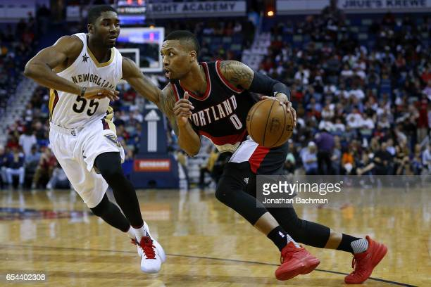 Damian Lillard of the Portland Trail Blazers drives against E'Twaun Moore of the New Orleans Pelicansduring the first half of a game at the Smoothie...