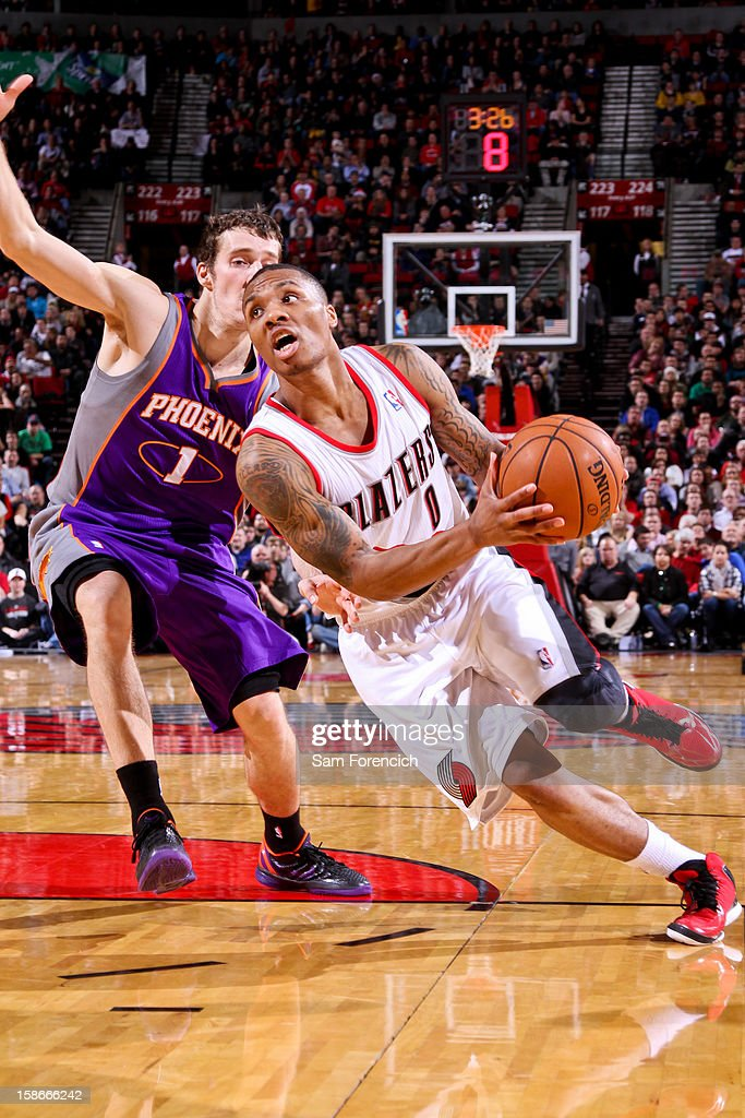 <a gi-track='captionPersonalityLinkClicked' href=/galleries/search?phrase=Damian+Lillard&family=editorial&specificpeople=6598327 ng-click='$event.stopPropagation()'>Damian Lillard</a> #0 of the Portland Trail Blazers drives against <a gi-track='captionPersonalityLinkClicked' href=/galleries/search?phrase=Goran+Dragic&family=editorial&specificpeople=4452965 ng-click='$event.stopPropagation()'>Goran Dragic</a> #1 of the Phoenix Suns on December 22, 2012 at the Rose Garden Arena in Portland, Oregon.