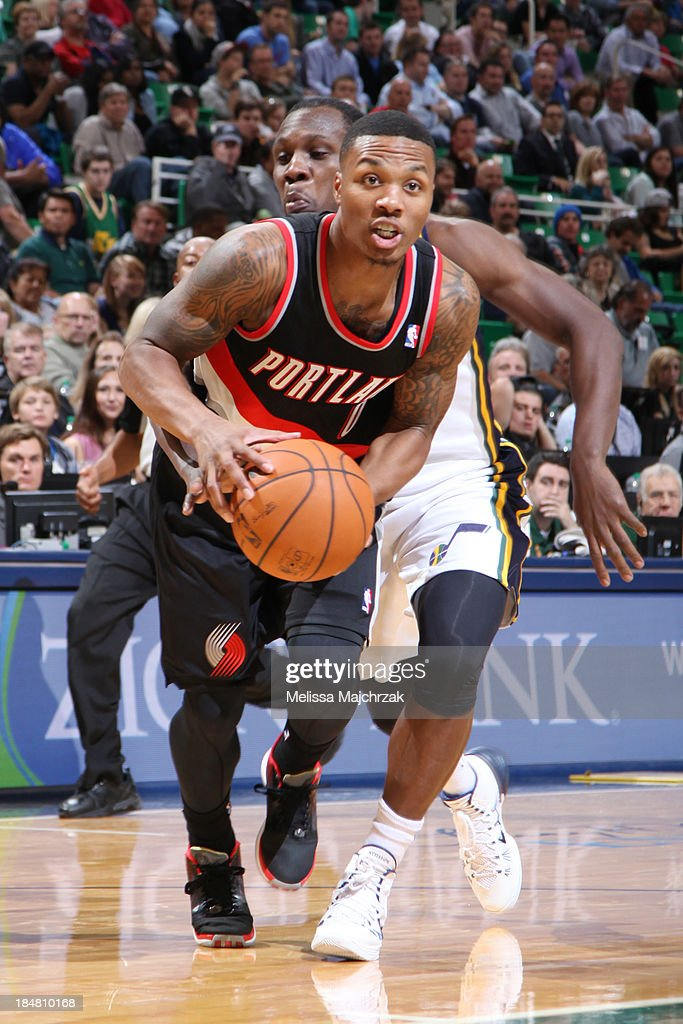 <a gi-track='captionPersonalityLinkClicked' href=/galleries/search?phrase=Damian+Lillard&family=editorial&specificpeople=6598327 ng-click='$event.stopPropagation()'>Damian Lillard</a> #0 of the Portland Trail Blazers drives against <a gi-track='captionPersonalityLinkClicked' href=/galleries/search?phrase=Lester+Hudson&family=editorial&specificpeople=5960156 ng-click='$event.stopPropagation()'>Lester Hudson</a> #6 of the Utah Jazz at Energy Solutions Arena on October 16, 2013 in Salt Lake City, Utah.