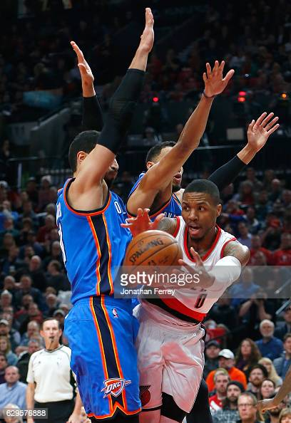 Damian Lillard of the Portland Trail Blazers drives against the Oaklahoma City Thunder at Moda Center on December 13 2016 in Portland Oregon NOTE TO...