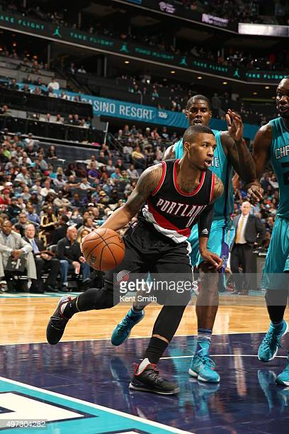 Damian Lillard of the Portland Trail Blazers drives against the Charlotte Hornets during the game at the Time Warner Cable Arena on November 15 2015...