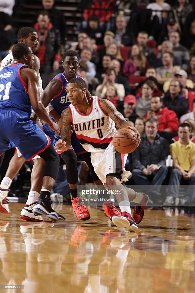 <a gi-track='captionPersonalityLinkClicked' href=/galleries/search?phrase=Damian+Lillard&family=editorial&specificpeople=6598327 ng-click='$event.stopPropagation()'>Damian Lillard</a> #0 of the Portland Trail Blazers drives during the game between the Philadelphia 76ers and the Portland Trail Blazers on December 29, 2012 at the Rose Garden Arena in Portland, Oregon.