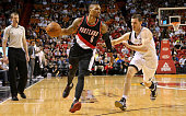 Damian Lillard of the Portland Trail Blazers drives on Goran Dragic of the Miami Heat during a game at American Airlines Arena on December 20 2015 in...