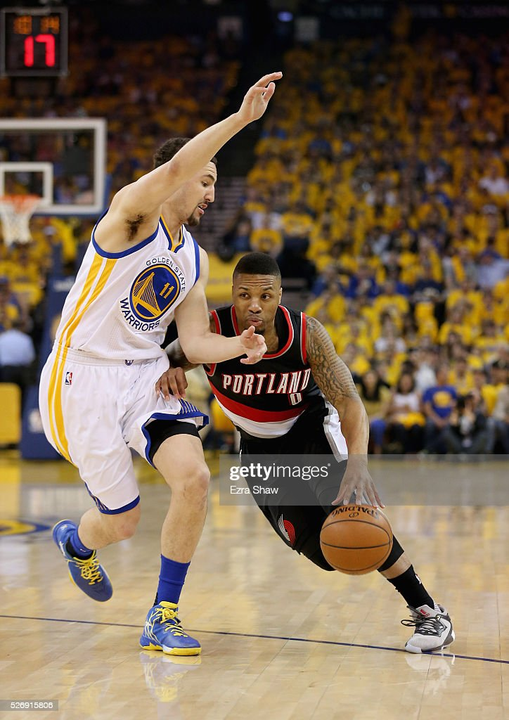 Damian Lillard #0 of the Portland Trail Blazers drives on Klay Thompson #11 of the Golden State Warriors during Game One of the Western Conference Semifinals for the 2016 NBA Playoffs at ORACLE Arena on May 01, 2016 in Oakland, California.