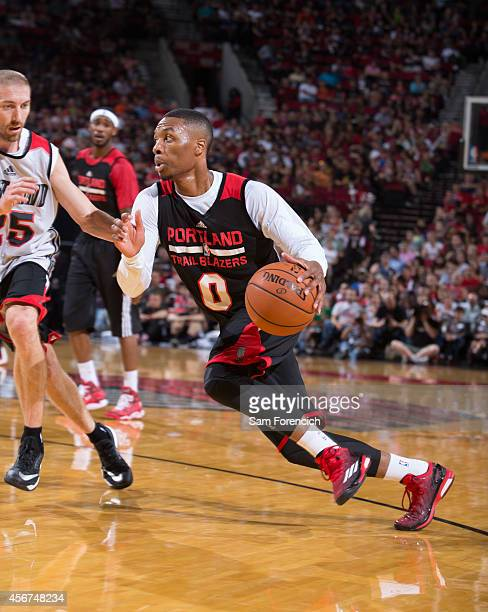 Damian Lillard of the Portland Trail Blazers drives on teammate Steve Blake of the Portland Trail Blazers while participating in the team's annual...