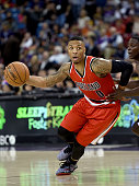 Damian Lillard of the Portland Trail Blazers drives past Darren Collison of the Sacramento Kings during the second half of their game at Sleep Train...
