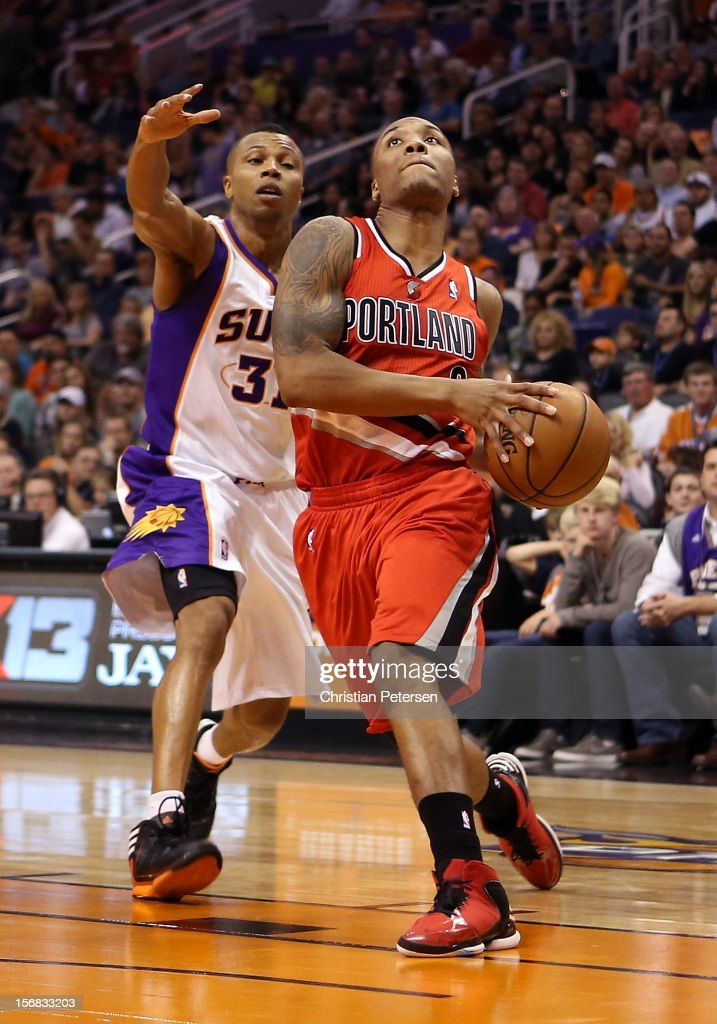 Damian Lillard #0 of the Portland Trail Blazers drives the ball past Sebastian Telfair #31 of the Phoenix Suns during the NBA game at US Airways Center on November 21, 2012 in Phoenix, Arizona.