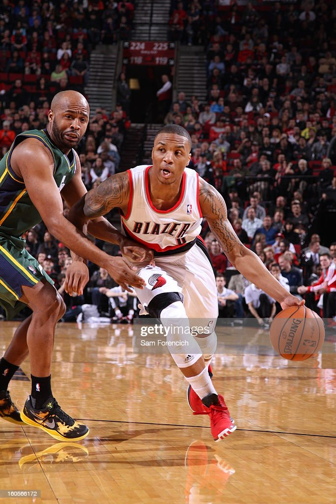 Damian Lillard #0 of the Portland Trail Blazers drives the ball under pressure during the game between the Utah Jazz and the Portland Trail Blazers on February 2, 2013 at the Rose Garden Arena in Portland, Oregon.