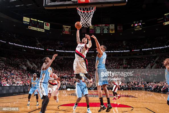 Damian Lillard of the Portland Trail Blazers drives to the basket and dunks the against the Denver Nuggets on January 23 2014 at the Moda Center...