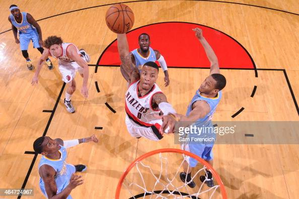 Damian Lillard of the Portland Trail Blazers drives to the basket and dunks the ball against the Denver Nuggets on January 23 2014 at the Moda Center...