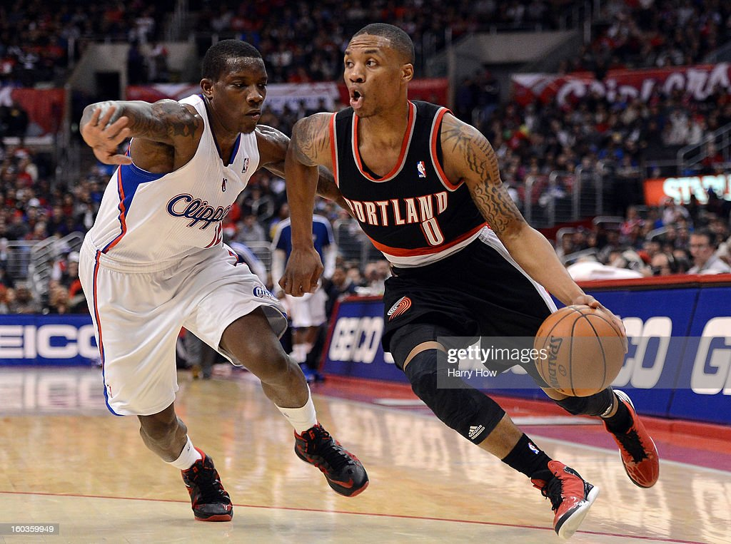 Damian Lillard #0 of the Portland Trail Blazers drives to the basket by Eric Bledsoe #12 of the Los Angeles Clippers at Staples Center on January 27, 2013 in Los Angeles, California.