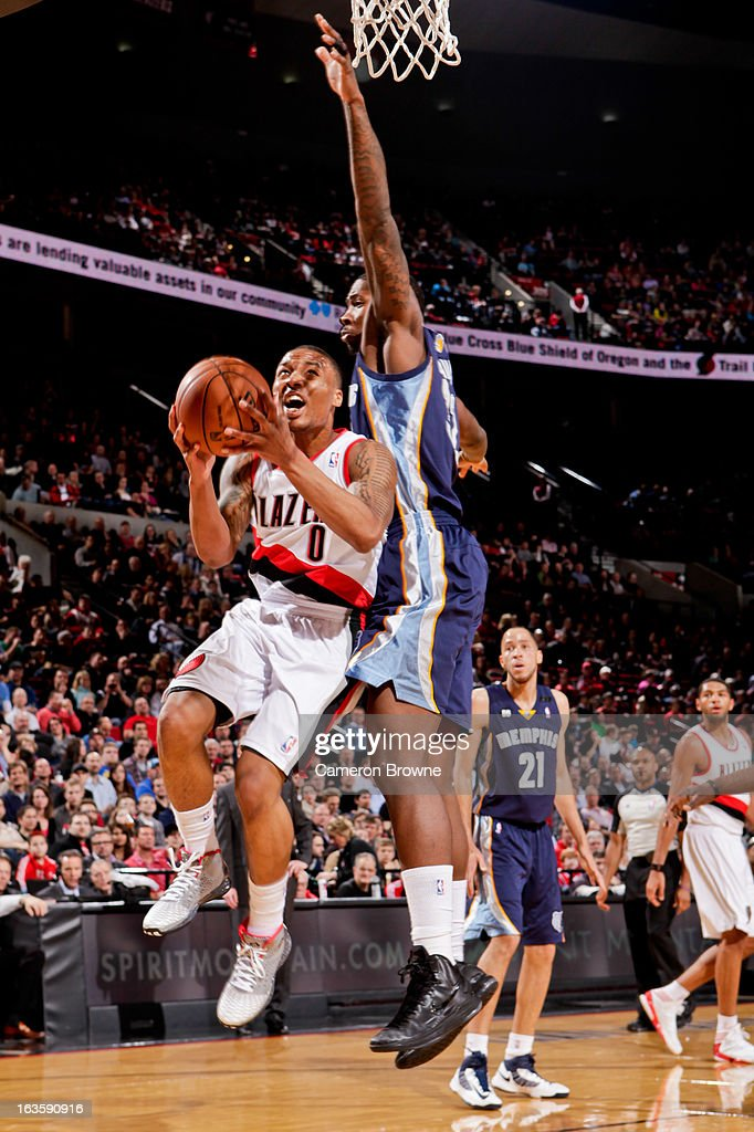 Damian Lillard #0 of the Portland Trail Blazers drives to the basket against Ed Davis #32 of the Memphis Grizzlies on March 12, 2013 at the Rose Garden Arena in Portland, Oregon.