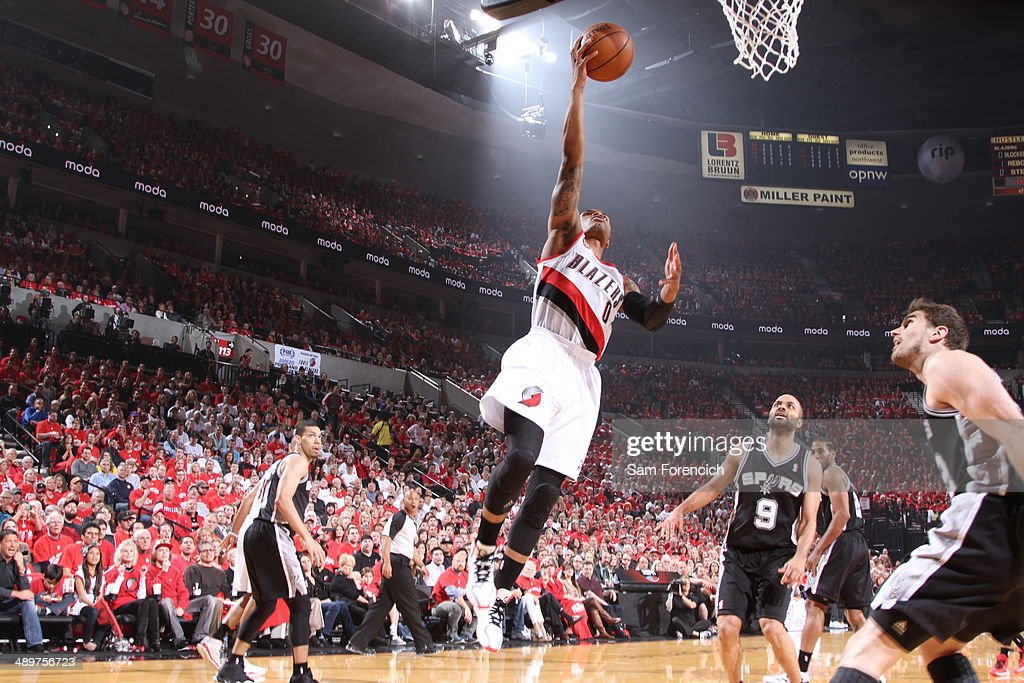 <a gi-track='captionPersonalityLinkClicked' href=/galleries/search?phrase=Damian+Lillard&family=editorial&specificpeople=6598327 ng-click='$event.stopPropagation()'>Damian Lillard</a> #0 of the Portland Trail Blazers drives to the basket in Game Three of the Western Conference Semifinals against the San Antonio Spurs during the 2014 NBA Playoffs on May 10, 2014 at the Moda Center in Portland, Oregon.