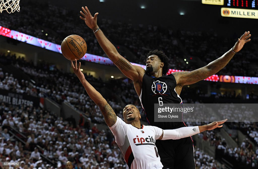 <a gi-track='captionPersonalityLinkClicked' href=/galleries/search?phrase=Damian+Lillard&family=editorial&specificpeople=6598327 ng-click='$event.stopPropagation()'>Damian Lillard</a> #0 of the Portland Trail Blazers drives to the basket on <a gi-track='captionPersonalityLinkClicked' href=/galleries/search?phrase=DeAndre+Jordan&family=editorial&specificpeople=4665718 ng-click='$event.stopPropagation()'>DeAndre Jordan</a> #6 of the Los Angeles Clippers in the third quarter of Game Three of the Western Conference Quarterfinals during the 2016 NBA Playoffs at the Moda Center on April 23, 2016 in Portland, Oregon. The Blazers won the game 96-88.