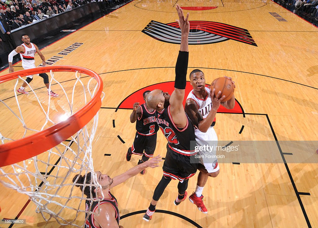 <a gi-track='captionPersonalityLinkClicked' href=/galleries/search?phrase=Damian+Lillard&family=editorial&specificpeople=6598327 ng-click='$event.stopPropagation()'>Damian Lillard</a> #0 of the Portland Trail Blazers drives to the basket against <a gi-track='captionPersonalityLinkClicked' href=/galleries/search?phrase=Taj+Gibson&family=editorial&specificpeople=4029461 ng-click='$event.stopPropagation()'>Taj Gibson</a> #22 of the Chicago Bulls on November 18, 2012 at the Rose Garden Arena in Portland, Oregon.