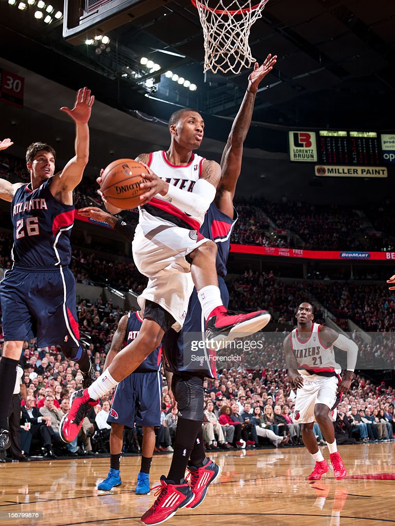 <a gi-track='captionPersonalityLinkClicked' href=/galleries/search?phrase=Damian+Lillard&family=editorial&specificpeople=6598327 ng-click='$event.stopPropagation()'>Damian Lillard</a> #0 of the Portland Trail Blazers drives to the basket past <a gi-track='captionPersonalityLinkClicked' href=/galleries/search?phrase=Kyle+Korver&family=editorial&specificpeople=202504 ng-click='$event.stopPropagation()'>Kyle Korver</a> #26 of the Atlanta Hawks on November 12, 2012 at the Rose Garden Arena in Portland, Oregon.