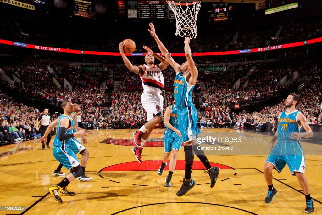 <a gi-track='captionPersonalityLinkClicked' href=/galleries/search?phrase=Damian+Lillard&family=editorial&specificpeople=6598327 ng-click='$event.stopPropagation()'>Damian Lillard</a> #0 of the Portland Trail Blazers drives to the basket against Anthony Davis #23 of the New Orleans Hornets on December 16, 2012 at the Rose Garden Arena in Portland, Oregon.