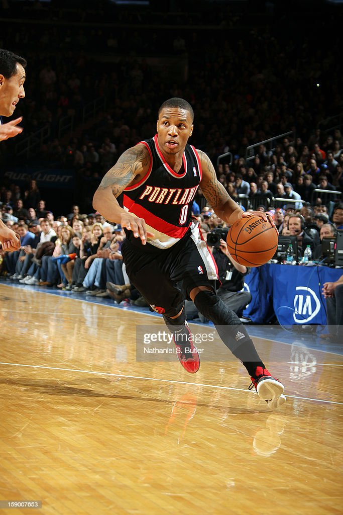 <a gi-track='captionPersonalityLinkClicked' href=/galleries/search?phrase=Damian+Lillard&family=editorial&specificpeople=6598327 ng-click='$event.stopPropagation()'>Damian Lillard</a> #0 of the Portland Trail Blazers drives to the basket against the New York Knicks on January 1, 2013 at Madison Square Garden in New York City.