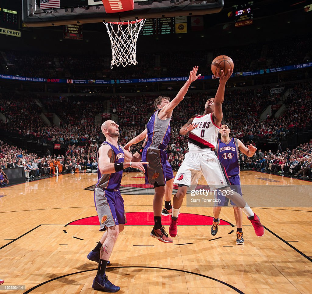 <a gi-track='captionPersonalityLinkClicked' href=/galleries/search?phrase=Damian+Lillard&family=editorial&specificpeople=6598327 ng-click='$event.stopPropagation()'>Damian Lillard</a> #0 of the Portland Trail Blazers drives to the basket against the Phoenix Suns on February 19, 2013 at the Rose Garden Arena in Portland, Oregon.