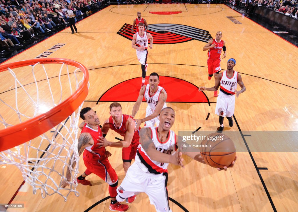<a gi-track='captionPersonalityLinkClicked' href=/galleries/search?phrase=Damian+Lillard&family=editorial&specificpeople=6598327 ng-click='$event.stopPropagation()'>Damian Lillard</a> #0 of the Portland Trail Blazers drives to the basket against the Los Angeles Clippers on January 26, 2013 at the Rose Garden Arena in Portland, Oregon.