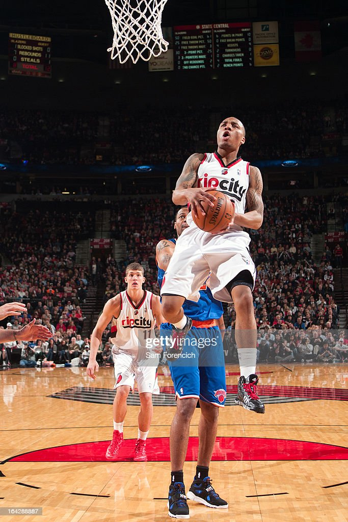 <a gi-track='captionPersonalityLinkClicked' href=/galleries/search?phrase=Damian+Lillard&family=editorial&specificpeople=6598327 ng-click='$event.stopPropagation()'>Damian Lillard</a> #0 of the Portland Trail Blazers drives to the basket against the New York Knicks on March 14, 2013 at the Rose Garden Arena in Portland, Oregon.