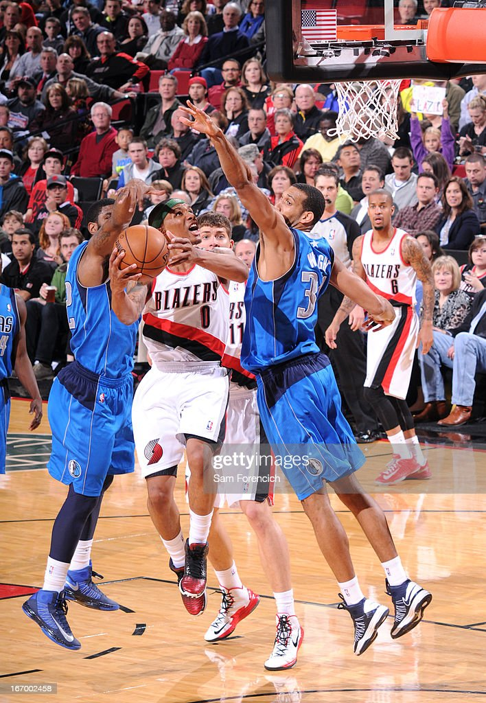 <a gi-track='captionPersonalityLinkClicked' href=/galleries/search?phrase=Damian+Lillard&family=editorial&specificpeople=6598327 ng-click='$event.stopPropagation()'>Damian Lillard</a> #0 of the Portland Trail Blazers drives to the basket against the Dallas Mavericks on April 7, 2013 at the Rose Garden Arena in Portland, Oregon.