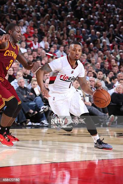 Damian Lillard of the Portland Trail Blazers drives to the basket against the Cleveland Cavaliers on November 4 2014 at the Moda Center in Portland...