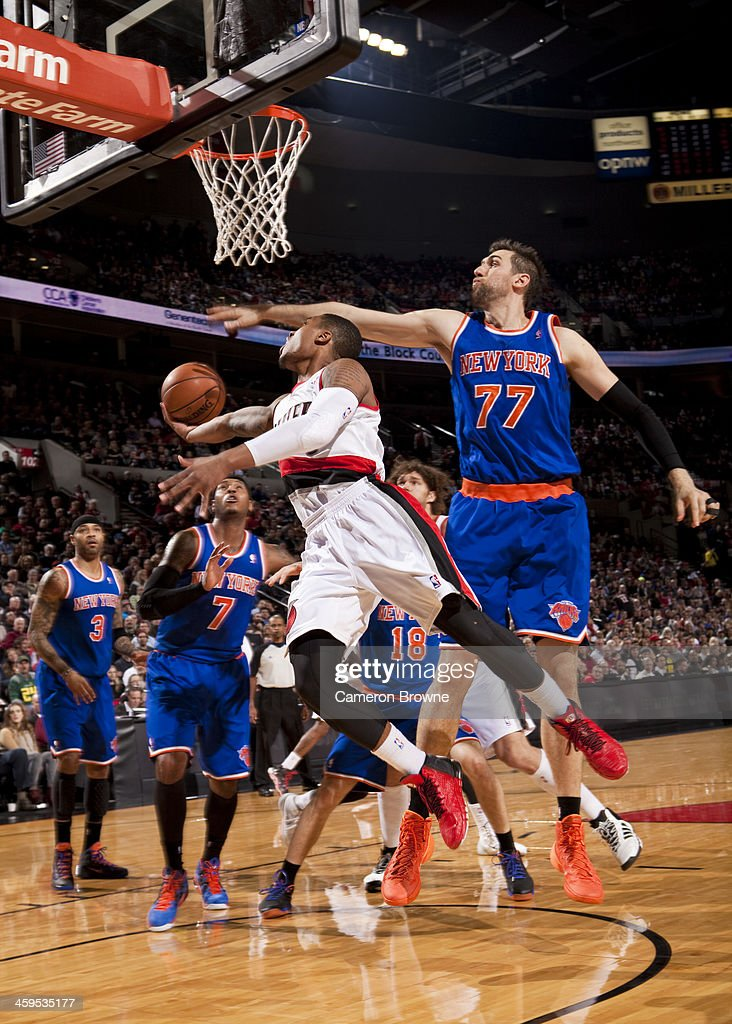 <a gi-track='captionPersonalityLinkClicked' href=/galleries/search?phrase=Damian+Lillard&family=editorial&specificpeople=6598327 ng-click='$event.stopPropagation()'>Damian Lillard</a> #0 of the Portland Trail Blazers drives to the basket against the New York Knicks on November 25, 2013 at the Moda Center Arena in Portland, Oregon.
