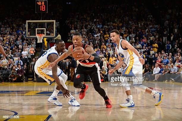 Damian Lillard of the Portland Trail Blazers drives to the basket against the Golden State Warriors during the game on April 9 2015 at ORACLE Arena...