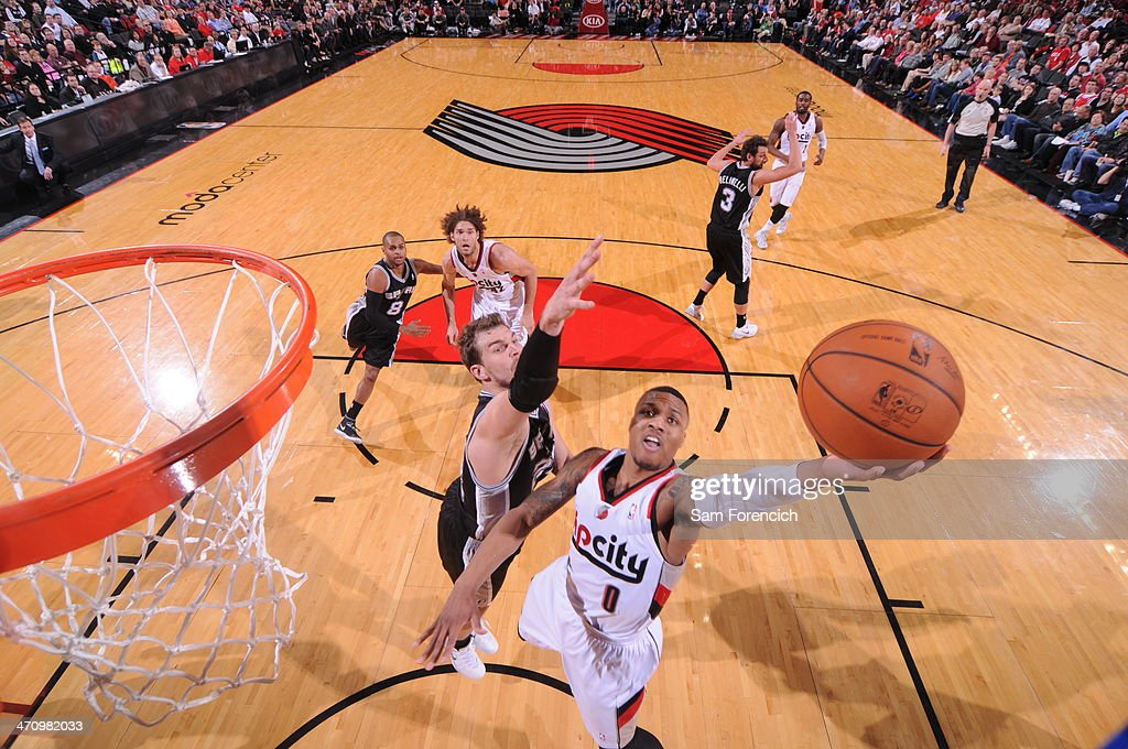 Damian Lillard #0 of the Portland Trail Blazers drives to the basket against the San Antonio Spurs on February 19, 2014 at the Moda Center Arena in Portland, Oregon.