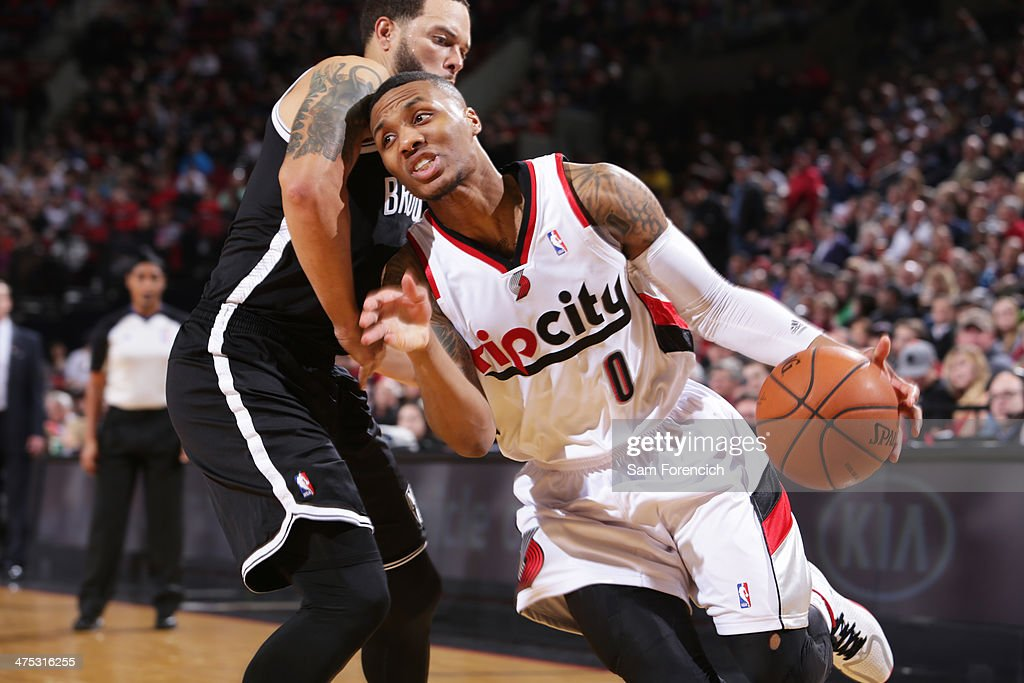 <a gi-track='captionPersonalityLinkClicked' href=/galleries/search?phrase=Damian+Lillard&family=editorial&specificpeople=6598327 ng-click='$event.stopPropagation()'>Damian Lillard</a> #0 of the Portland Trail Blazers drives to the basket against the Brooklyn Nets on February 26, 2014 at the Moda Center Arena in Portland, Oregon.