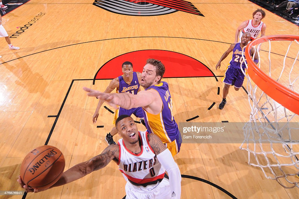 <a gi-track='captionPersonalityLinkClicked' href=/galleries/search?phrase=Damian+Lillard&family=editorial&specificpeople=6598327 ng-click='$event.stopPropagation()'>Damian Lillard</a> #0 of the Portland Trail Blazers drives to the basket against the Los Angeles Lakers on March 3, 2014 at the Moda Center Arena in Portland, Oregon.