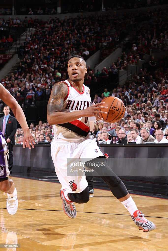 <a gi-track='captionPersonalityLinkClicked' href=/galleries/search?phrase=Damian+Lillard&family=editorial&specificpeople=6598327 ng-click='$event.stopPropagation()'>Damian Lillard</a> #0 of the Portland Trail Blazers drives to the basket against the Sacramento Kings on April 9, 2014 at the Moda Center Arena in Portland, Oregon.