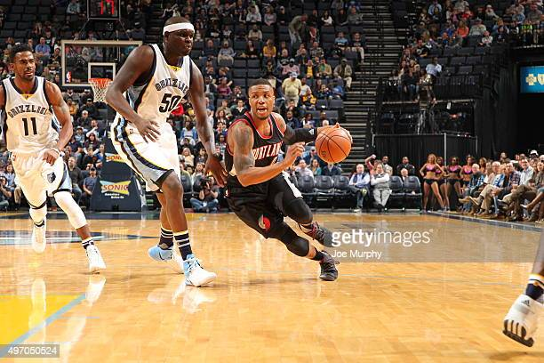 Damian Lillard of the Portland Trail Blazers drives to the basket against Zach Randolph of the Memphis Grizzlies on November 13 2015 at FedExForum in...