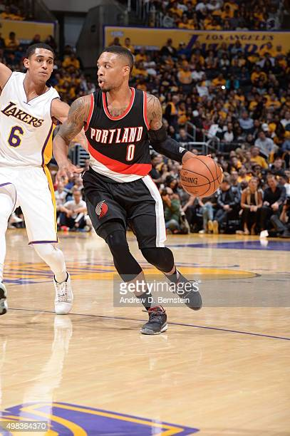 Damian Lillard of the Portland Trail Blazers drives to the basket against Jordan Clarkson of the Los Angeles Lakers on November 22 2015 at STAPLES...